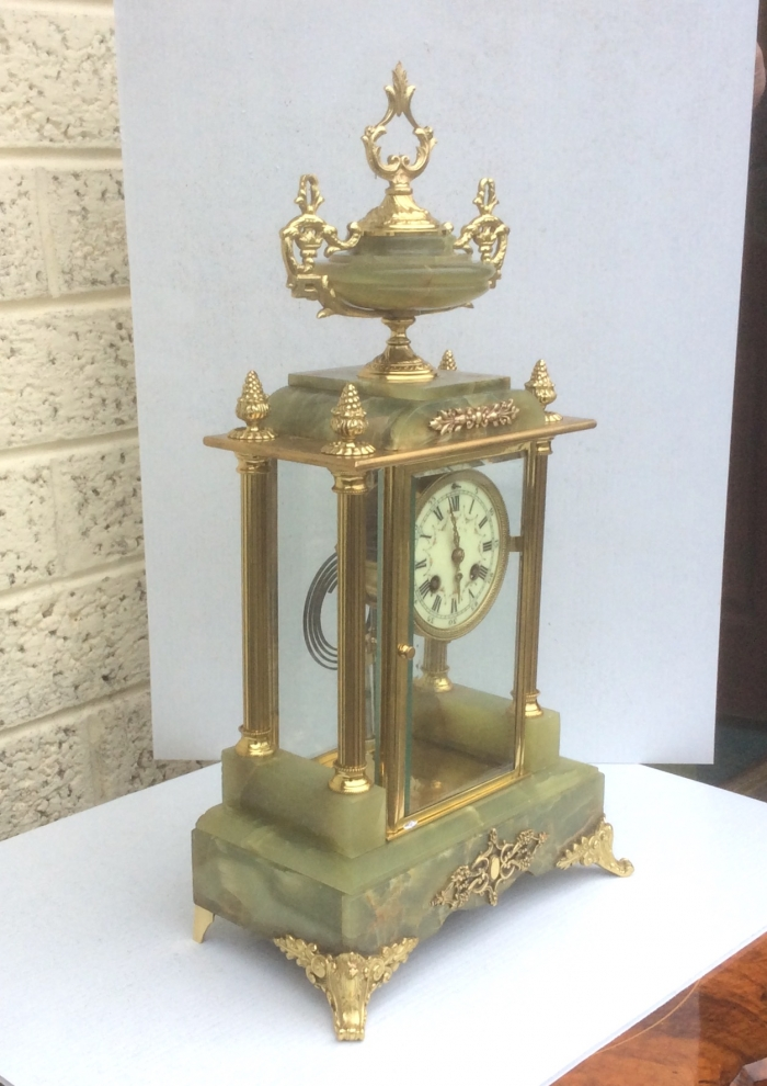 Stunning four glass onyx and brass mantel clock