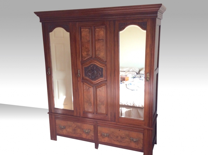 An excellent quality walnut and mahogany Antique three door wardrobe