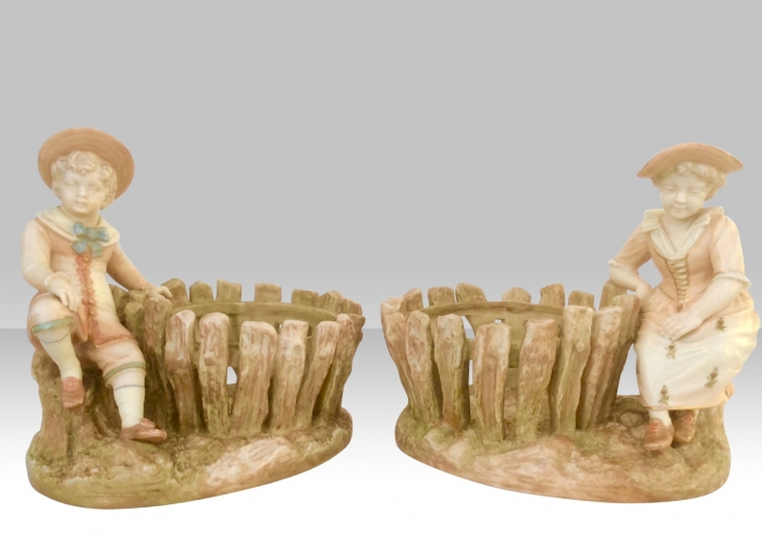 Lovely Pair of Antique Royal Worcester Basket Figurines Of Boy And Girl Sitting At A Fence signed by Hadley