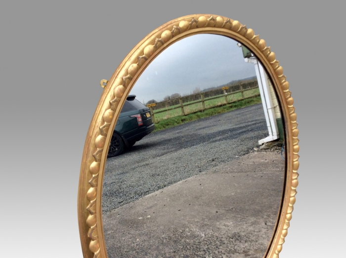 Fabulous Large Antique English Giltwood Oval Wall Mirror.