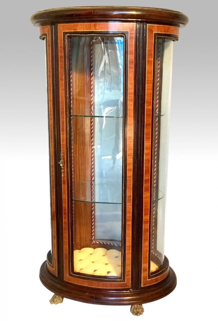 A Bijouterie Pedestal Display Cabinet Vitrine of oval shape.