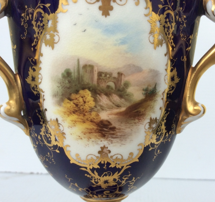 A stunning antique Coalport three handled chalice tig cup.