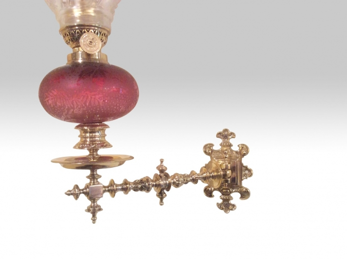 A wonderful rare pair of antique wall mounted ruby glass peg oil lamps .