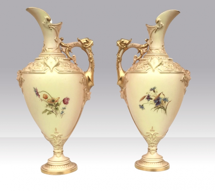 A beautiful pair of antique Royal Worcester blush ivory pedestal ewers