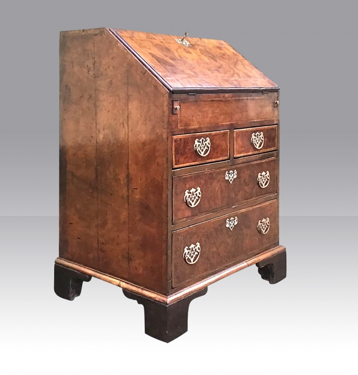 An early George I Walnut Antique Bureau of small proportions.
