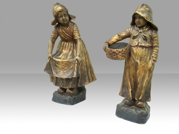 Fabulous pair of antique Goldscheider figures Of boy and girl