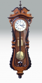 Fabulous Serpentine Shaped Antique Vienna Black and Walnut Wall Clock.  - Click to Enlarge