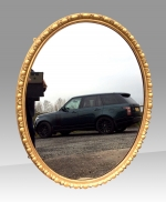 Fabulous Large Antique English Giltwood Oval Wall Mirror. - Click to Enlarge